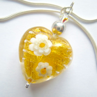 Gold daisy patterned Murano glass heart pendant with sterling silver.