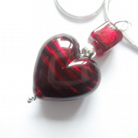 Deep red Murano glass heart and cube pendant with sterling silver.