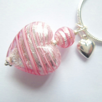 Pink and silver Murano glass heart pendant with sterling silver charm and chain.