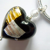 Black,silver and gold Murano glass heart pendant with sterling silver chain.