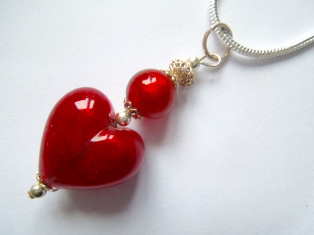 Red Murano glass and sterling silver heart pendant.