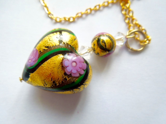 Pink and gold decorated Murano glass pendant with sterling silver.