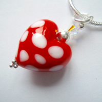 Red and white polka dot Murano glass heart pendant with sterling silver.