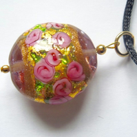 Pink and gold Murano glass pendant with black satin cord.