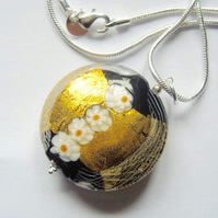 Black and gold large Murano glass pendant with sterling silver snake chain.