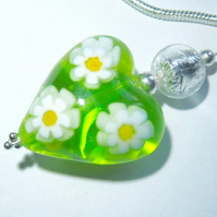 Green and white Murano glass heart pendant with sterling silver chain.