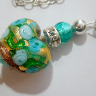 Blue and green Murano glass pendant with Swarovski crystal and sterling silver.