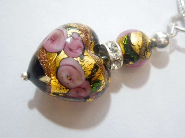 Pink and gold Murano glass pendant with Swarovski crystal and sterling silver.