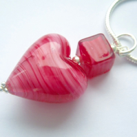 Pink Murano glass heart pendant with sterling silver.