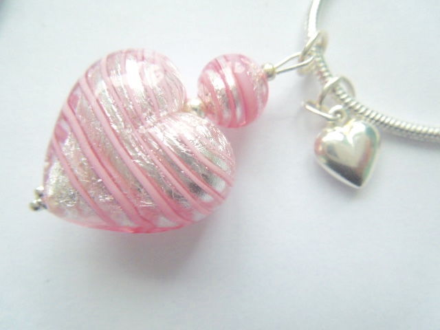 Murano glass pink and silver heart pendant with sterling silver charm.