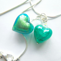 Green Murano glass double heart pendant with Swarovski and sterling silver.