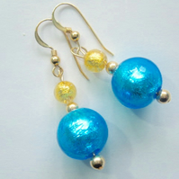 Turquoise Murano glass earrings with gold filled ear hooks.