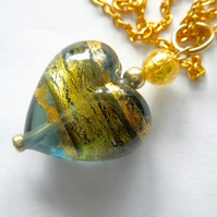 Murano glass green and gold Murano glass heart pendant.