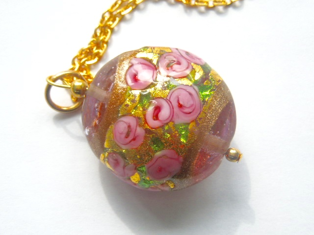 Murano glass pink and gold pendant with gold chain..