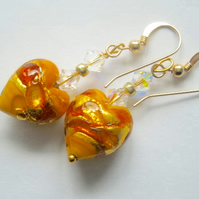 Murano glass gold heart earrings with Swarovski crystal and gold filled hoods.