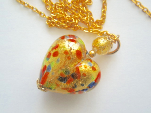 Murano glass gold heart pendant.