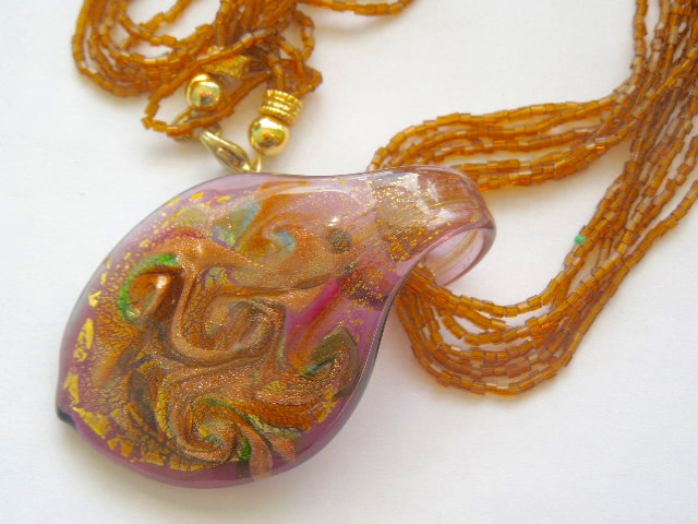 Murano glass brown and gold pendant with beaded strands.