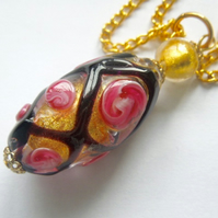 Murano glass black and gold rose pendant.