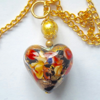 Murano glass gold and black decorated heart pendant.