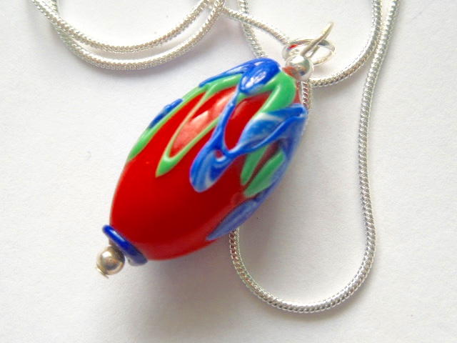 Red Murano glass pendant with sterling silver.