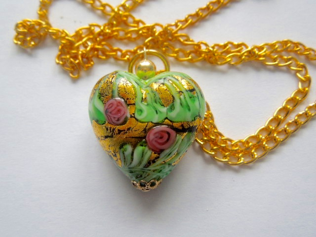 Gold Murano glass decorated heart pendant.