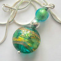 Green Murano glass pendant with sterling silver.
