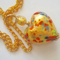 Gold Murano glass  heart pendant.