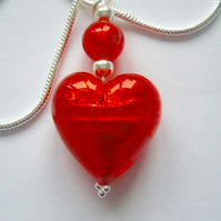 Murano glass red heart pendant with sterling silver.