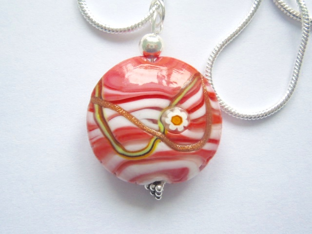 Pink Murano glass lentil pendant with sterling silver.