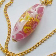 Pink and gold Murano glass pendant.