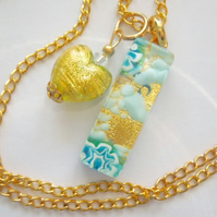 Gold and blue Murano glass heart pendant with Swarovski and gold chain.