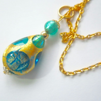 Gold and green Murano glass pear drop pendant with gold chain.