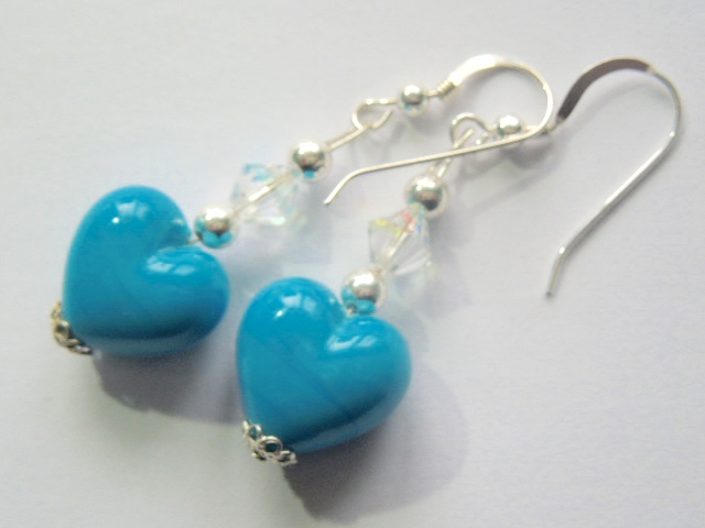 Turquoise blue Murano glass heart earrings with sterling silver.
