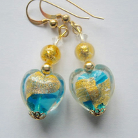 Gold and turquoise Murano glass heart earrings with gold filled wires.