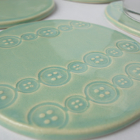Set of 4 green ceramic button textured coasters
