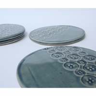 Set of 4 blue ceramic button textured coasters