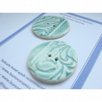 Two green porcelain flock textured buttons