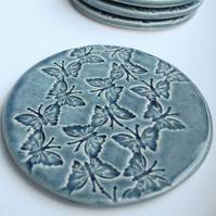 INC P&P  - Set of 4 blue ceramic butterfly textured coasters