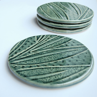 INC P&P  - Set of 4 green ceramic textured coasters