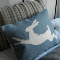 hand printed muted blue stitched leaping hare cushion