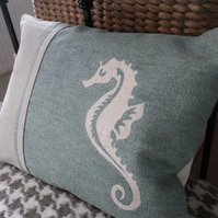 Pale, duck egg sea horse cushion.