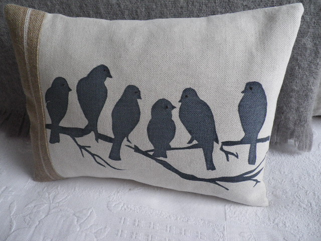 hand printed midnight blue linen bird on branch cushion