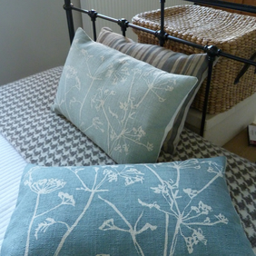 hand printed muted textured teal blue cow parsley cushion