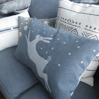 Exclusive hand printed muted blue leaping hare in snow cushion cover