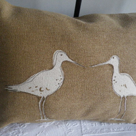 Hand printed muted  acorn gold  wading bird pair cushion