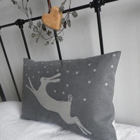 Exclusive hand printed pewter leaping hare in snow cushion