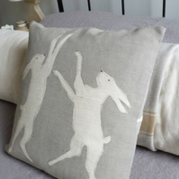 hand printed dove grey boxing hares cushion