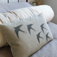 hand printed swallow silhouette cushion