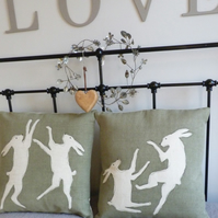 hand printed pale olive boxing hare  pair set of cushions