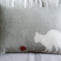 hand printed muted grey cat cushion with little wool ball